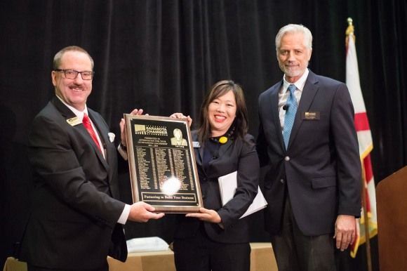 SRQ Media President & CEO Lisl Liang receives recognition for her service as Board Chair at 94th Annual Membership Meeting.  Photo Credit: Senior Photographer Evan Sigmund