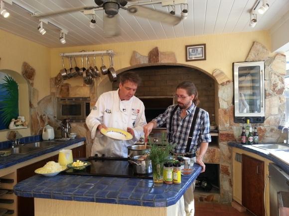 Chef Rolf Zahnd of Chef Rolf's New Florida Kitchen teaches SRQ Staff Writer Phil Lederer how to prepare polenta.