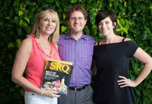 LeAnn Swor and a member of her team accept L. Boutique and L. Spa's Best of SRQ Local certificates with Publisher Wes Roberts. Photo Credit: Shane Donglasan