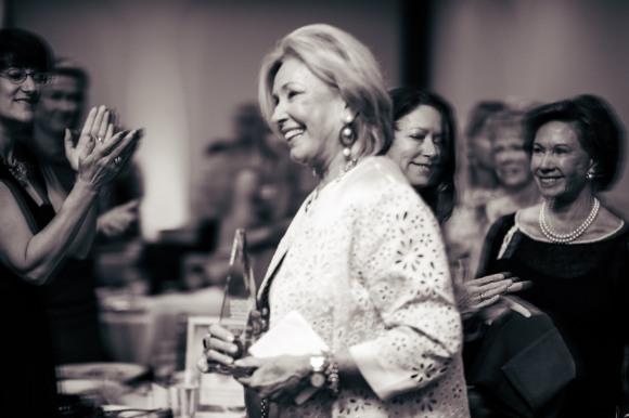Adrienne Vittadini accepts the Trailblazer award at SRQ Hear Me Roar luncheon. Photo credit: Evan Sigmund