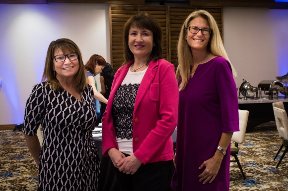 From L to R: Nancy Morgan and Dr. Elizabeth Callahan pose for a photo with Ashley Grant of SRQ Media. Photo credit: Shane Donglasan
