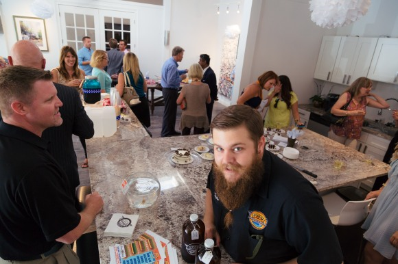 Taylor Pogue of JDub's Brewing Company provides guests with samples of season craft brews. Photo Credit: Evan Sigmund