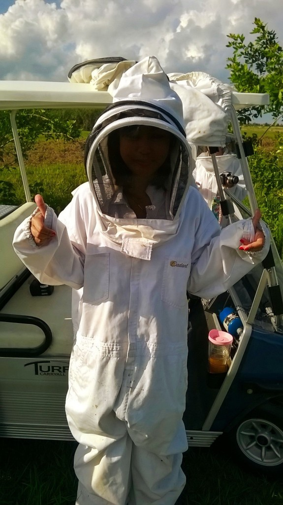 SRQ Assistant Editor Shane Donglasan is decked out in a beekeeper's suit for an upcoming story in the August issue of SRQ Magazine. Photo credit: Kaye Warr