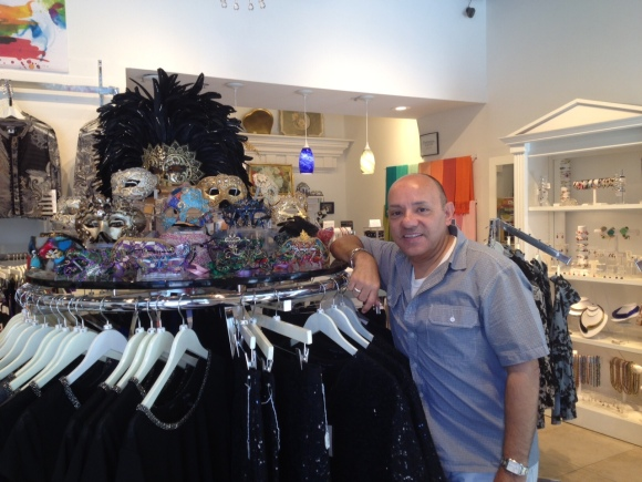 Anthony Vento, owner of i tesori on Main Street in Sarasota, and a portion of his Venetian mask inventory. Photo credit: Mary Darby Guidroz