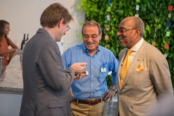 SRQ Executive Publisher Wes Roberts (left) catches up with Mustafa Yilmaz (center) and ____. Photo credit: Wyatt Kostygan