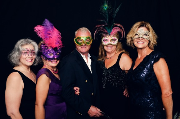 Guests of 2014 Bal Masqué enjoy the photo booth.