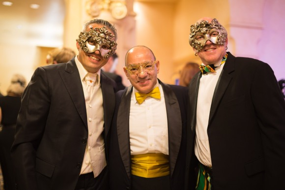 Anthony Vento (center) wears a mask from his store in downtown Sarasota, i tesori. Photo Credit: Evan Sigmund