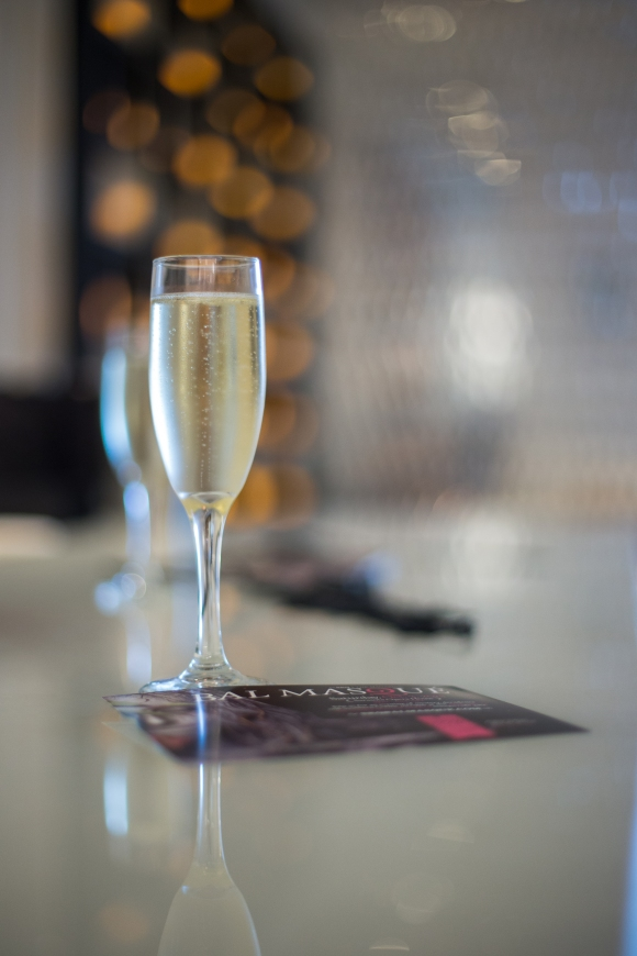Champagne greeted guests as they arrived to the Bal Masque VIP Preview Party. Photo Credit: Wyatt Kostygan