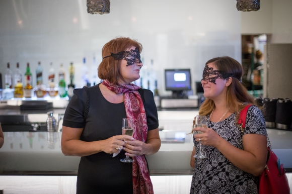 Marybeth Flynn (left) and Kelly Davis Strausbaugh enjoyed conversation and libations at the Bal Masque Preview Party. Photo Credit: Wyatt Kostygan
