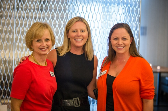 Jayna Haymel (Left) of Women in Business Sponsor, Seaside Bank smiles with SRQ Sales & Business Development Associate Jennifer Miller (Center) and Gabriele Vest of Grapevine Communications and the 2015 Leadership Circle at the Women in Business Kickoff. Photo credit: Wyatt Kostygan