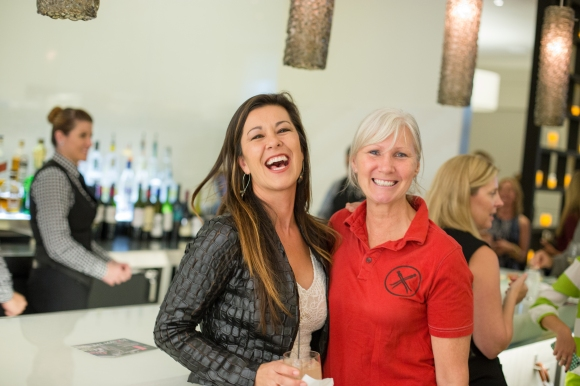 Rosemary Angeleri, owner of Clever Rose in downtown Sarasota and Denise Kowal of the Sarasota Chalk Festival (2015 Leadership Circle Member) at the Women in Business Kickoff Celebration. Photo Credit: Wyatt Kostygan
