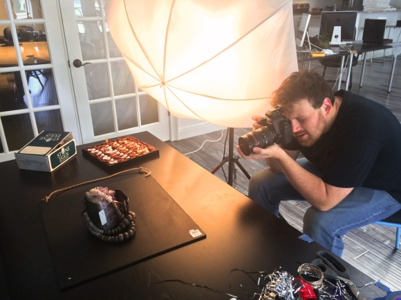 SRQ Photographer Wyatt Kostygan takes careful photos of our December Holiday Gift Guide feature, on newsstands December 1st! Photo credit: Mary Darby Guidroz