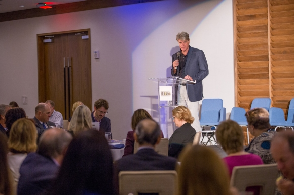 Steve Ellis, co-founder of MGB Homes shared the company giving philosophy before introducing the keynote speaker. Photo credit: Wyatt Kostygan