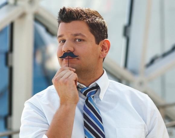 F-NathanSchwagler_Headshot_Mustache--cmyk.jpg
